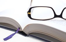 Glasses On An Open Book Closeup Royalty Free Stock Image