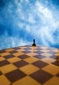 Chess Pawn On A Chessboard Royalty Free Stock Photo