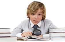 Schoolboy With Books And Magnifying Glass Stock Photo