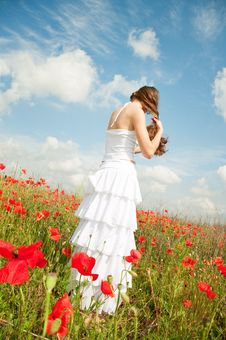 Girl In Poppies Stock Images