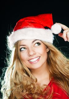 Young Pretty Girl In Santa Hat Royalty Free Stock Photo