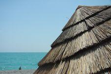 Beach Straw Umbrella Stock Photo