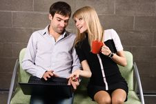 Young Man And Woman Sitting With A Laptop Stock Images