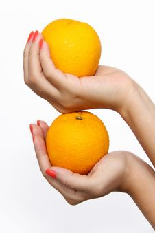Free Holding Stacked Oranges Stock Photo - 14981240