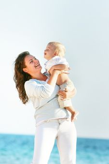 Free Mother Playing With Son On Sea Background Royalty Free Stock Images - 14983969