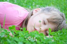 Free Girl Sleeping In The Grass Stock Photos - 14985713