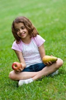 Girl With Red Apple And Pear Royalty Free Stock Image