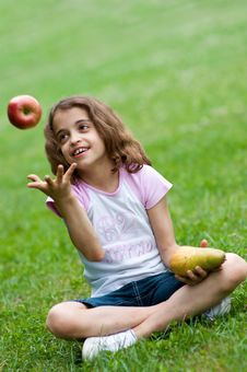 Free Girl With Red Apple And Pear Royalty Free Stock Photo - 14985995