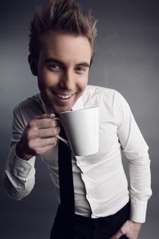 Free Young Attractive Macho Drinking Coffe Stock Photos - 14986013