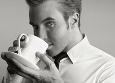 Free Young Attractive Macho Drinking Coffe Stock Photography - 14986022