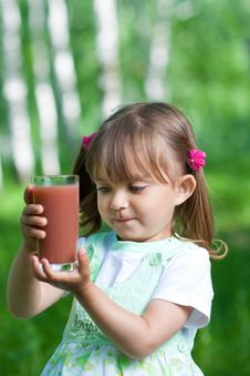 Free Little Girl Portrait With Glass Plum Juice Royalty Free Stock Photos - 14986168