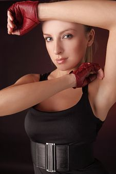 Attractive Posing Blonde In A Red Sport Gloves Royalty Free Stock Photo