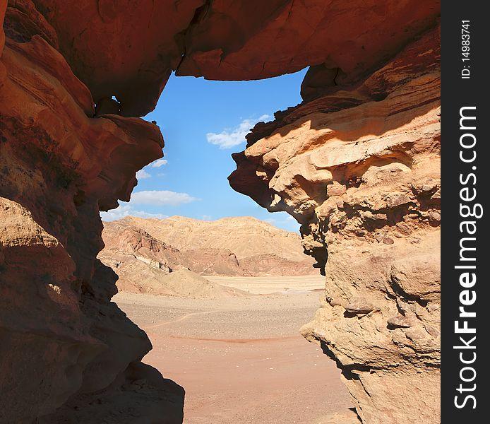Window in the orange sandstone rock in desert