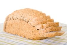 Sliced Wholemeal Brown Bread Placed On Linen Cloth Royalty Free Stock Photos