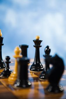 Free Chessmen On A Chessboard Royalty Free Stock Photo - 14993395