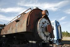 Closeup Photo Of An Old Steam Locomotive Engine With A Train Car In The Background Stock Photos