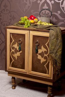 Free Wooden Chest Of Drawers In East Style With Fruits Royalty Free Stock Image - 14998126