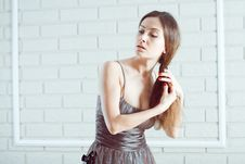 Lady Combing Stock Image