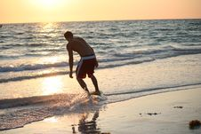 Free Skim Boarding At Sunset Royalty Free Stock Photo - 15003175