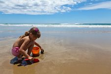 A Girl Playing On The Wet Sand Royalty Free Stock Photography