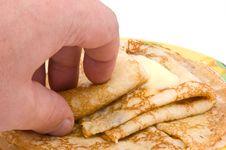 Free The Hand Takes Pancakes Stock Photos - 15004443