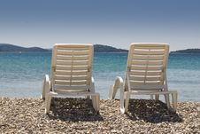 Free Plastic Chairs On The Beach Stock Photo - 15006350