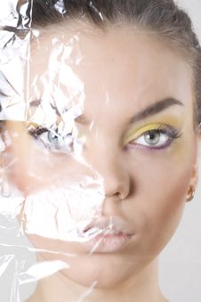 Female Face Wrapped In Cellophane Stock Images