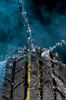 Free Tire With Water Drop Royalty Free Stock Photos - 15009068