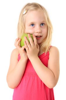 Free Beautiful Smiling Child With A Green Apple Stock Image - 15009081