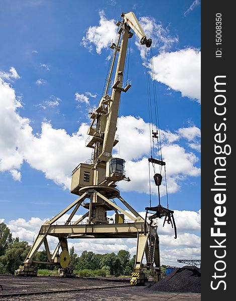 Crane at a dock with blue sky