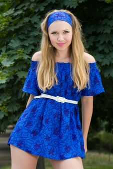Free Pretty Young Woman In Blue Dress Posing Royalty Free Stock Images - 15011339