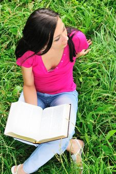 Free Woman With A Book On The Grass Royalty Free Stock Photos - 15011788