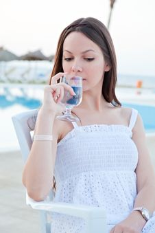 Woman With Wine Near A Pool Stock Photo