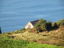 Free Small Cottage Near The Sea Stock Photos - 15015213