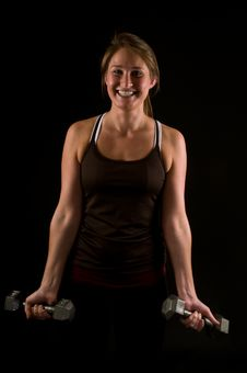 Young Woman Lifiting Weights Stock Image