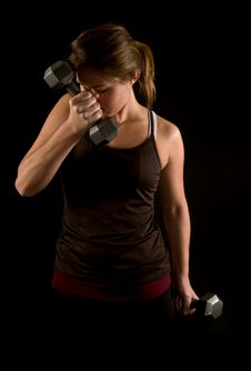 Young Woman Lifiting Weights Stock Images