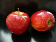 Free Two Red Apples On A Black Background Royalty Free Stock Photography - 15017437