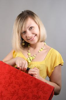 Free Smiling Girl In Yellow Shirt With Red Bag Royalty Free Stock Photography - 15018097