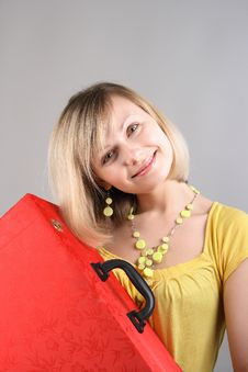 Free Smiling Girl In Yellow Shirt With Red Bag Stock Images - 15018174