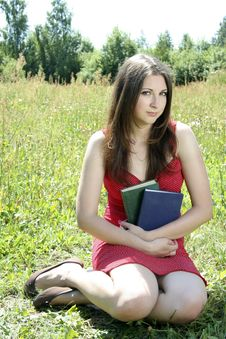 Teen Girl Sitting On The Grass Stock Images