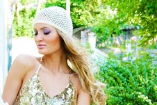 Pretty Serene Fashionable Woman In The Park Stock Photo