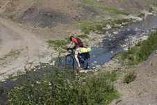 Free Mountain Biker Crossing River Stock Images - 15019414