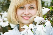 Free Young Girl With Magnolia Royalty Free Stock Photo - 15019835