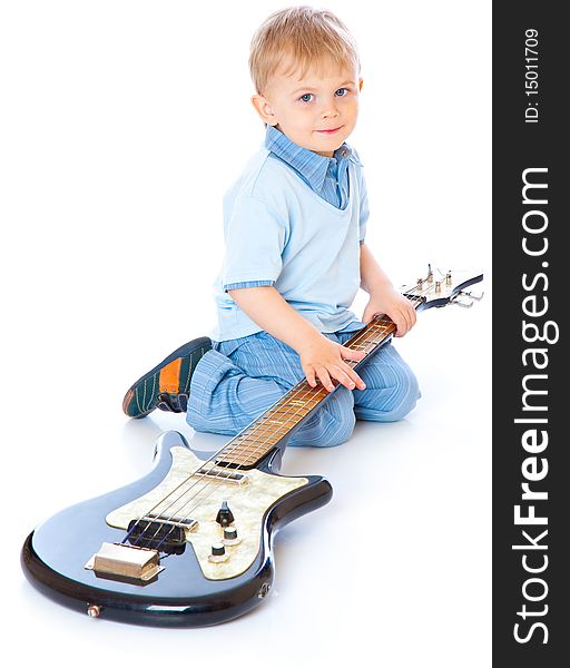 Little boy with guitar