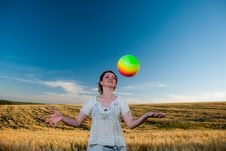 Young Woman Playing Ball Stock Photo