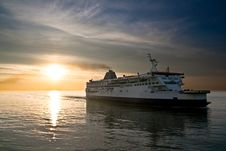 Ferry Boat On The Sunset In The Sea Royalty Free Stock Image
