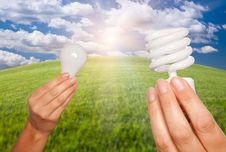 Female Hands Holding Light Bulbs Stock Photos