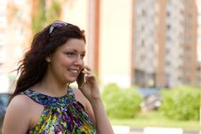 Free Woman Is Talking Mobile Phone Outdoors. Royalty Free Stock Images - 15025439