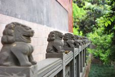 Free A Bird Stands With The Stone Lions Stock Image - 15026211