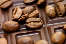 Background From Coffee Beans And Chocolate Stock Image